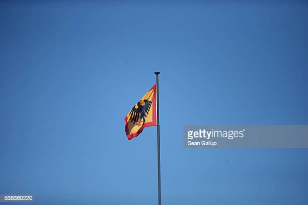 The presidential eagle hangs over Schloss Bellevue presidential palace under a blue sky on June 6 2016 in Berlin Germany German President Joachim...