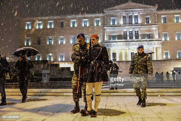 The presidential guard at the tomb of the Unknown Soldier unable to walk on the icy street during a snowfall in Athens Greece on January 9 2017...
