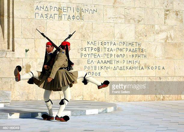 The Presidential Guards guard the Tomb of the Unknown Solder which is located in front of the Greek Parliament Building in Athens, Greece, near the...