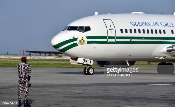 The presidential jet of the Nigerian Air Force arrives at the Felix HouphouetBoigny Airport in Abidjan on November 28 2017 / AFP PHOTO / ISSOUF SANOGO