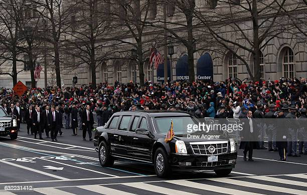 The presidential limousine carrying US President Donald Trump and first lady Melania Trump drives the parade route during the Inaugural Parade on...