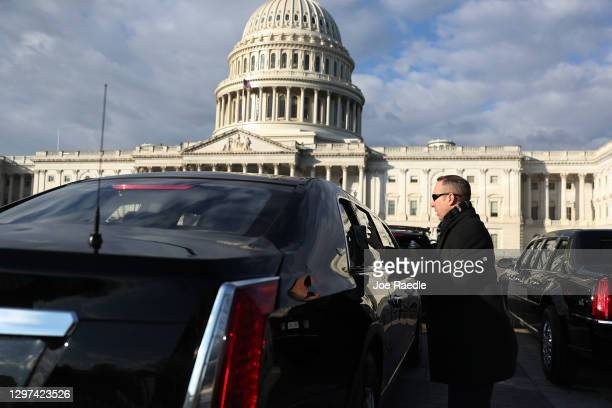 The presidential limousine is cleaned outside of the U.S. Capitol before the inauguration of U.S. President-elect Joe Biden on the East Front of the...
