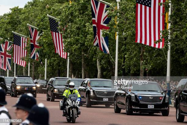 The Presidential motorcade carrying US President Donald Trump makes its way down the Mall to Buckingham Palace after a visit to Clarence House on...