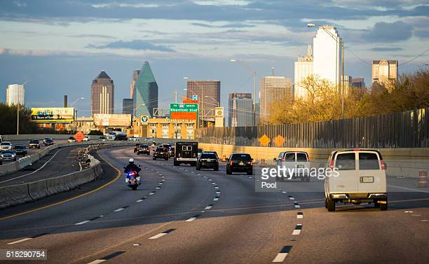The presidential motorcade drives east on Interstate 30 toward Dallas Love Field Airport March 12 2016 in Dallas Texas Obama spoke a day after...