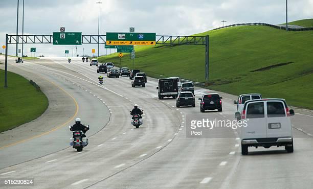 The presidential motorcade drives south on Walton Walker Blvd toward Dallas National Golf Club March 12, 2016 in Dallas, Texas. Obama spoke a day...