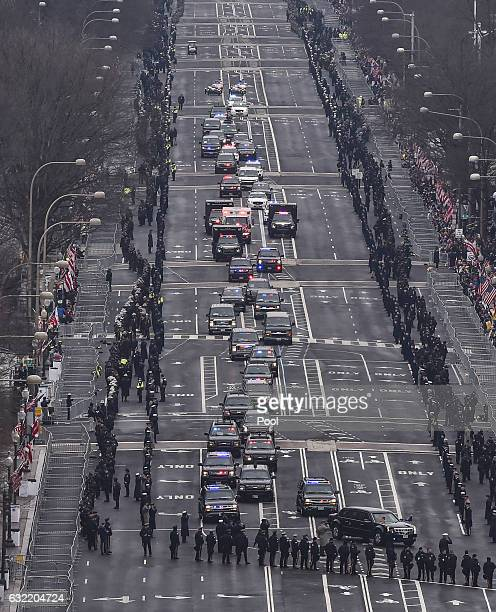 The Presidential motorcade makes its way down Pennsylvania Ave on route to the US Capitol for the inauguration of Presidentelect Donald Trump on...