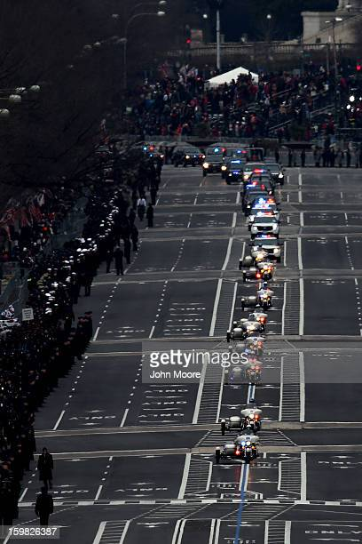 The presidential motorcade travels down Pennsylvania Ave. During the presidential inauguration January 21, 2013 in Washington, DC. Barack Obama was...