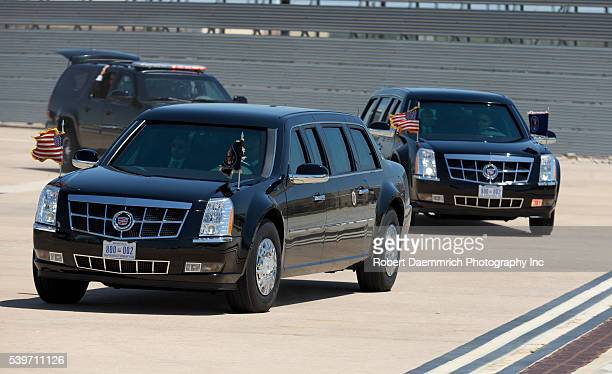 The presidential motorcade with President Barack Obama and First Lady Michelle Obama arrives at Austin-Bergstrom Airport after leaving the LBJ Civil...