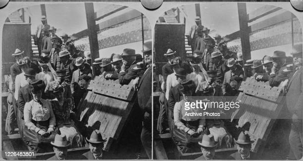 The presidential party accompanying US President William McKinley on his tour of the nation, descend the 3,000 foot shaft into the Congress Gold Mine...