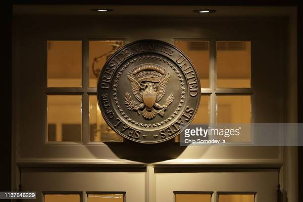 The presidential seal hangs above the door to the White House West Wing shortly after special counsel Robert Mueller delivered his report on Russian...