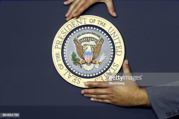 The presidential seal is affixed is affixed to a podium before US President Donald Trump not pictured speaks at an event to discuss tax reform at the...