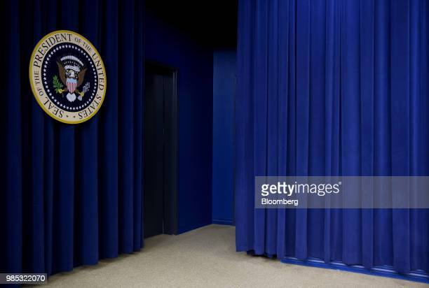 The Presidential seal is displayed on a curtain before a FacetoFace With Our Future event with US President Donald Trump in the South Court...