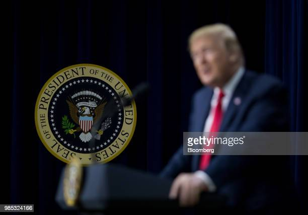 The Presidential seal is displayed while US President Donald Trump speaks during a FacetoFace With Our Future event in the South Court Auditorium of...