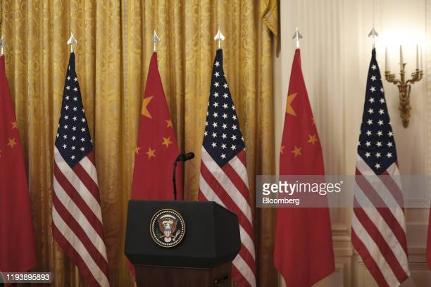 """The presidential seal is seen on a podium before a signing ceremony for the U.S.-China """"phase-one"""" trade agreement with President Donald Trump in..."""