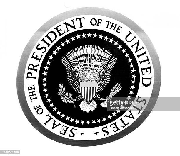 The presidential seal on the door of Air Force One as the plane sits on the tarmac at Agana International Airport in Agana Guam Air Force One brought...