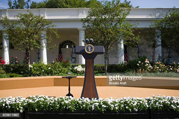 The presidential seal podium and stage inthe Rose Garden at the White House