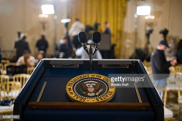 The presidential seal sits on the podium of President Barack Obama after a news conference in the East Room of the White House in Washington DC