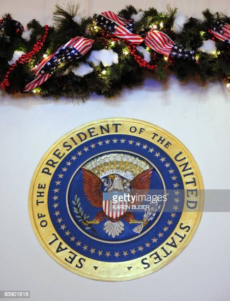 The Presidential Seal with holiday decoration above the door to the Blue Room during the White House Holiday media preview at the White House in...