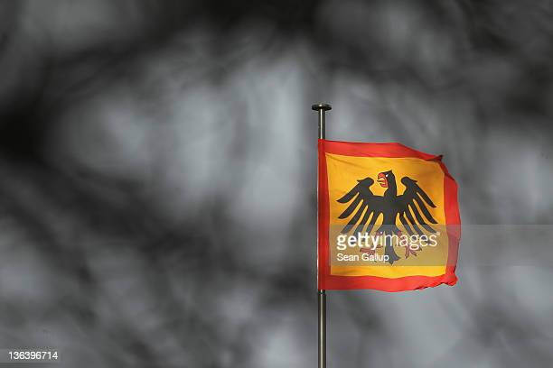 The Presidential standard, seen through the branches of a tree, flies over Schloss Bellevue presidential palace on January 4, 2012 in Berlin,...