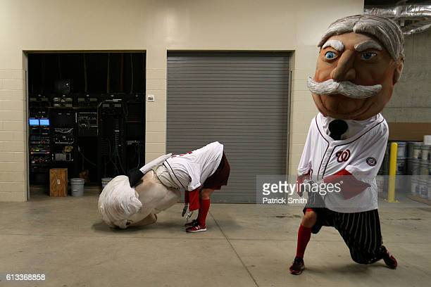 The Presidents Race mascots rehearse prior to game two of the National League Division Series between the Los Angeles Dodgers and the Washington...
