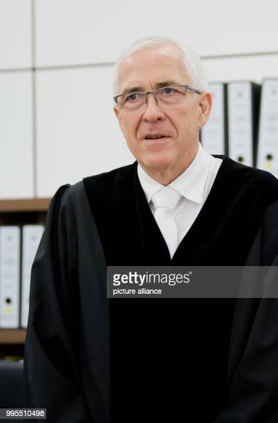 The presiding judge Frank Rosenow stands in High Regional Court of Celle Germany 26 September 2017 At the High Regional Court the trial against the...