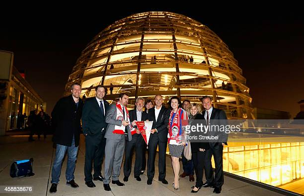 The presidium of the 'Berliner Fraktion' the first fan club of FC Bayern Muenchen at German Bundestag pose with Paul Breitner and Raimond Aumann of...