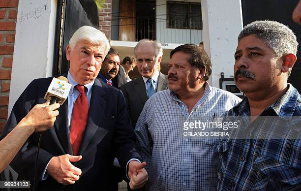 The press approaches US Senators Christopher J Dood and Bob Corker as they walk next to Honduran National Popular Resistance Front leaders Rafael...