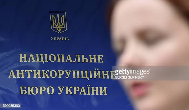 The press secretary of the National AntiCorruption Bureau of Ukraine speaks during an interview with AFP in front of the bureau's offices in Kiev on...