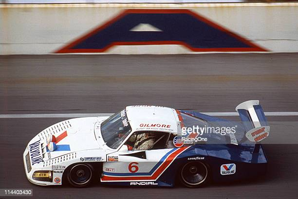 The Preston Hennowned Porsche 935L races on the high banks of Daytona International Speedway during the SunBank 24 at Daytona The driving trio of A J...