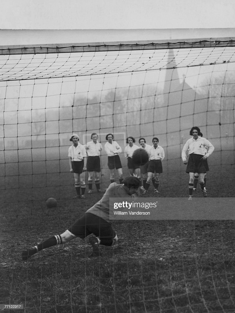 The Preston Ladies Football Club practise taking penalty kicks during a training session, circa 1935. They will be attempting to retain their world championship title in Belgium in a year's time.