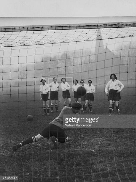 The Preston Ladies Football Club practise taking penalty kicks during a training session, circa 1935. They will be attempting to retain their world...