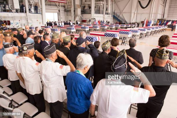 The presumed remains of US soldiers from the Korean War rest at Hangar 19 Joint base Pearl Harbor Hickam August 1 2018 in Honolulu Hawaii US Vice...