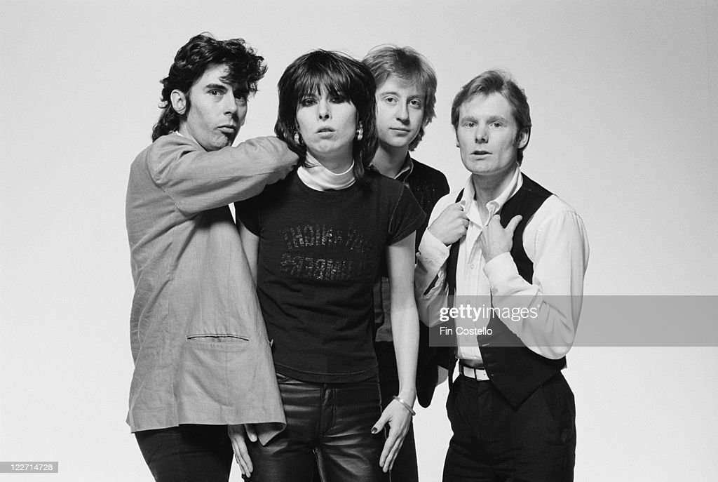 The Pretenders (bassist Pete Farndon (1952-1983), singer and guitarist Chrissie Hynde, guitarist James Honeyman-Scott (1956-1982) and drummer Martin Chambers), British rock band, pose for a group studio portrait, against a white background, United Kingdom, in January 1979.