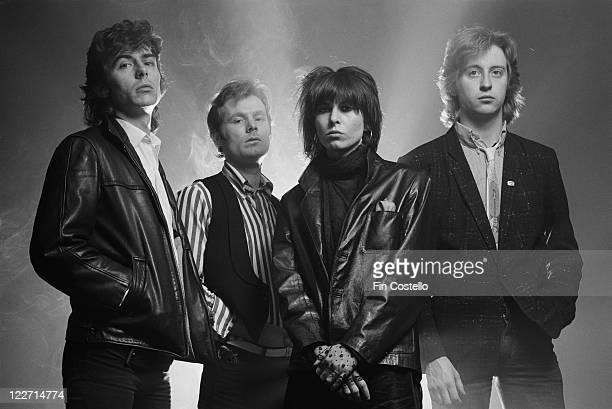 The Pretenders , British rock band, pose for a group studio portrait, against a smoky background, United Kingdom, in January 1979.