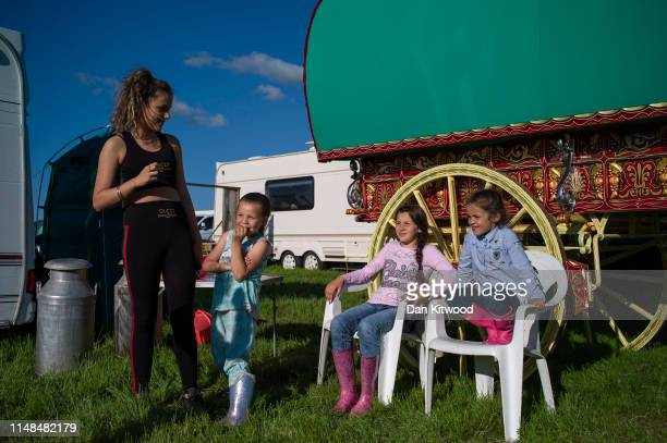 The Price family stands outside their Bow Top caravan during the annual Appleby Horse Fair on June 06 2019 in ApplebyinWestmorland England The annual...