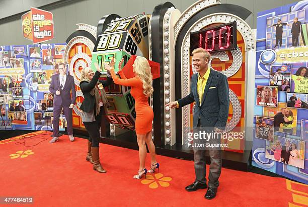 The Price is Right model Rachel Reynolds and host George Gray with contestants during the The Price is Right popup at 2014 SXSW Music Film...