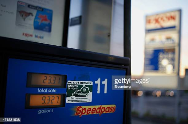 The price of unleaded fuel is displayed on a pump at an Exxon Mobil Corp gas station in Richmond Kentucky US on Wednesday April 29 2015 Exxon Mobil...