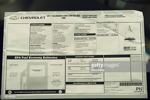 The price sticker is displayed on a General Motors Corp Chevrolet Silverado pickup truck at dealership in Colma California US on Tuesday July 5 2011...