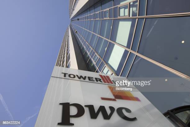 The PricewaterhouseCoopers LLP logo sits on a sign outside 51-storey skyscraper Tower 185 in Frankfurt, Germany, on Wednesday, Oct. 18. 2017. In a...