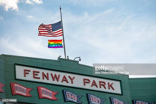 The Pride flag is flown above the facade along with the American flag at half mast in recognition of the Orlando night club shooting before a game...