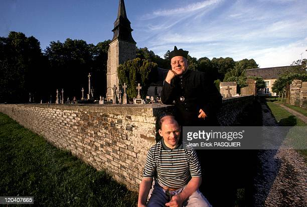 The Priest And His Beadle In France In 1987 Christian the beadle is MongolianQuintin has changed his lifeThey pose in front of the cemetery the...