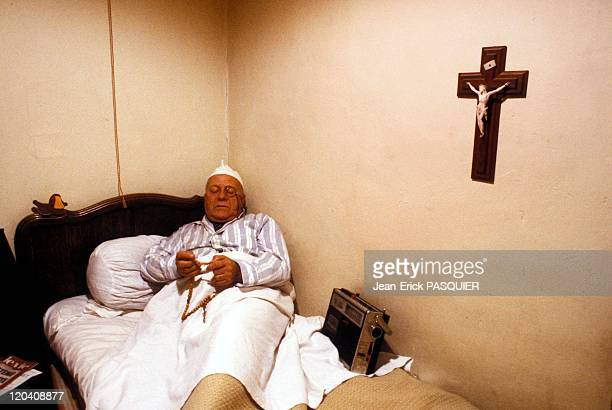 The Priest In Bed In France In 1987 Wearing a nightcap to the old abbot told his rosary in one ear listening to the BBC the only radio listening...