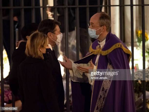 The priest of Notre Dame basilica Franklin Parmentier welcome outside the mayor of Nice Christian Estrosi and his wife Laura Tenoudji before a mass...