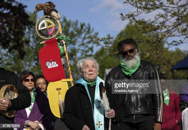 The priest Peter Powel and members of American Indian Center hold a walk to mark their new American Indian Center home in Chicago United States on...