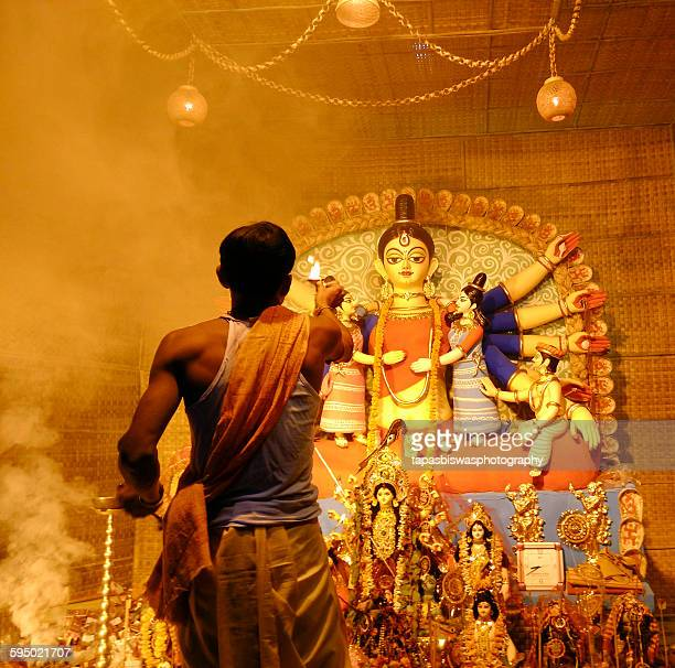 the priest - durga stock photos and pictures