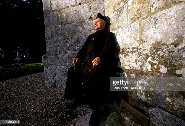 The Priest Takes The Sun In France In 1987 A moment of rest and a bit of solar heat reflected by the wall centenary of his churcha Country Priest...