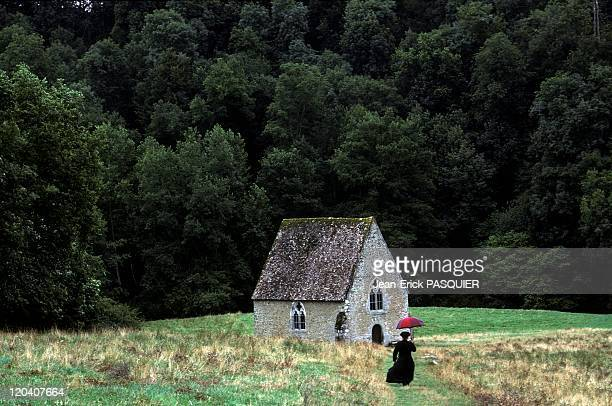 The Priest The Umbrella In France In 1987 Amateur old churchHe goes here to the chapel of St Ceneri in the Alps Mancelles in Normandy a Country...