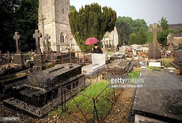 The Priest To Cemetery In France In 1987 Despite the rain we must address the maintenance of the cemeterya Country Priest Father Montgomery Quintin...