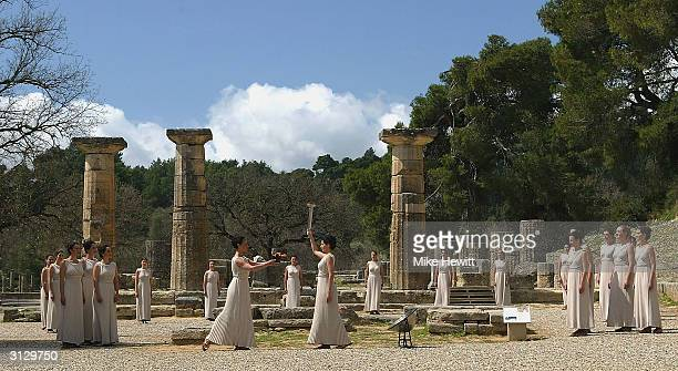 The Priestesses gather around the flame during The Ceremony of the Lighting of the Olympic Flame for the Athens 2004 Olympic Games at the Ancient...