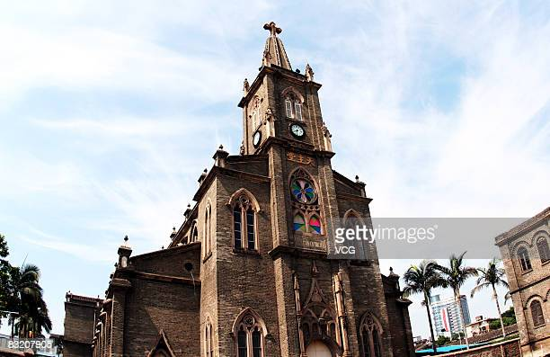 The Priest's House of Fanchuanpu Church is lifted up in preparation for relocation to its new site July 3 2008 in Fuzhou city east China's Fujian...